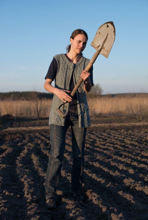 Female farmer with spade stock photo