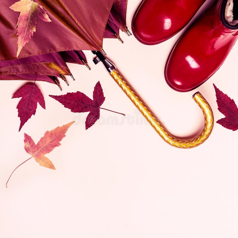 Female fashion autumn accessories shoes and umbrella on pastel color background. Beauty and fashion concept.  stock photo