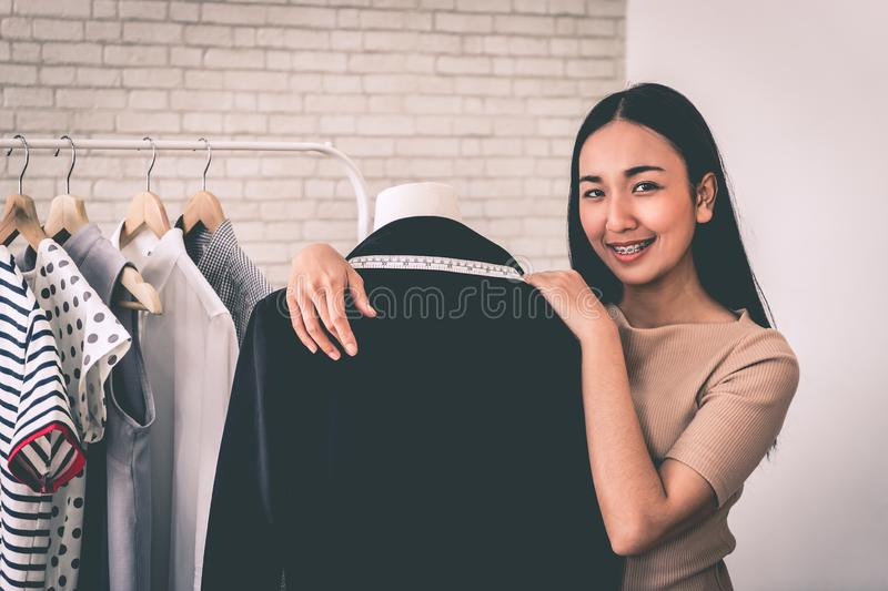 Fashion designer tailor is measuring office suit jacket royalty free stock images