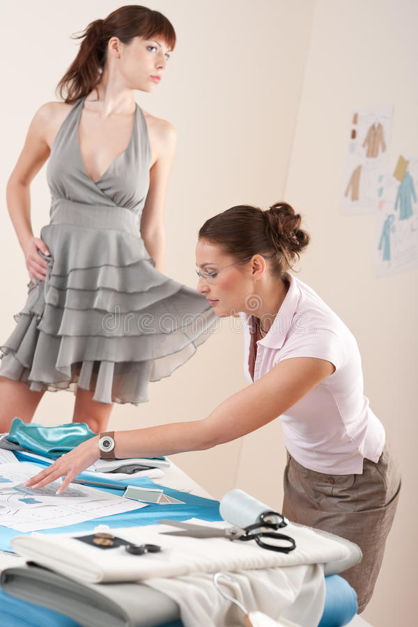 Female Fashion Designer Trying Dress On Model Stock Image Image 12116723