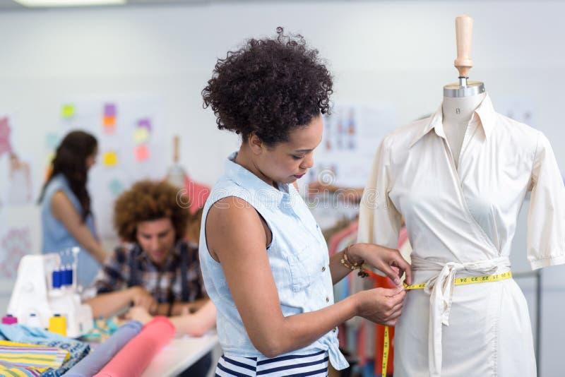 Female fashion designer at work. Portrait of female fashion designer at work stock images