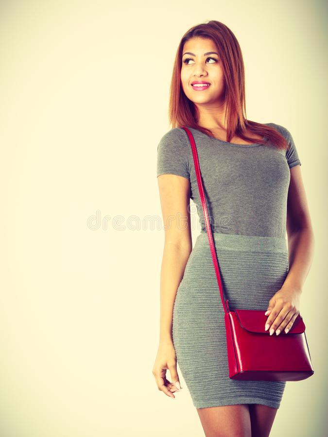Mulatto girl gray wear with red handbag royalty free stock photography
