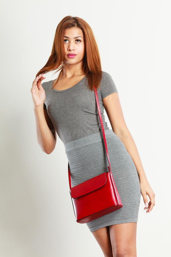 Mulatto girl gray wear with red handbag stock images