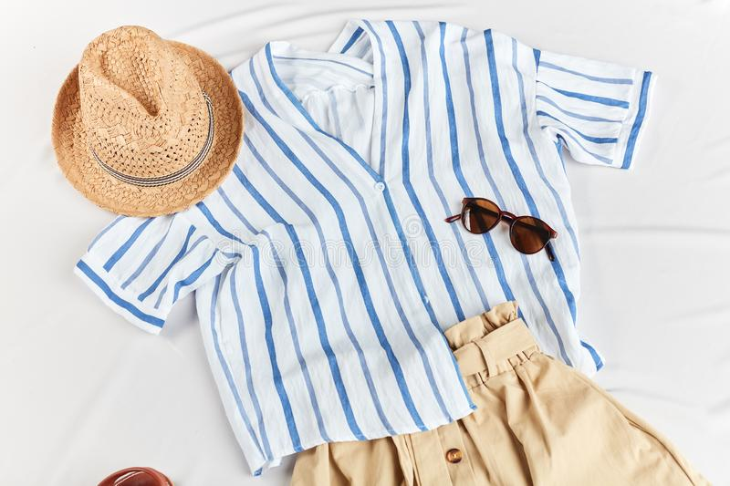 Female fashionable outfit for summer warm days. Woman has bought clothes for vacation, holiday stock image