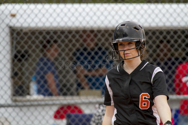 Female Fastpitch Softball Player Heading Into The Batters Box Sizing Up The Pitcher royalty free stock photography