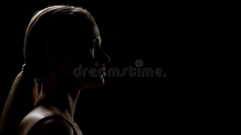Female feeling imperfect, looking with fear forward, fighting insecurities stock image