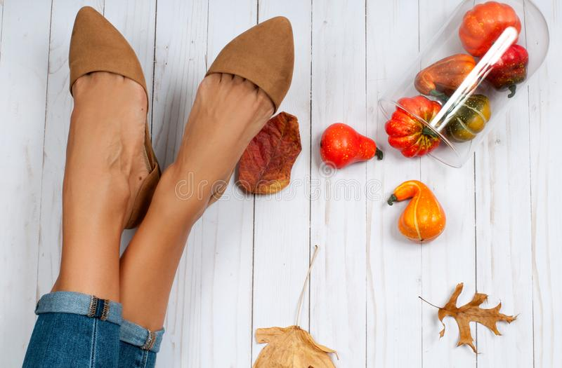 Autumn accessories, female feet and fashion shoes. Female feet and fashion shoes, autumn accessories royalty free stock images
