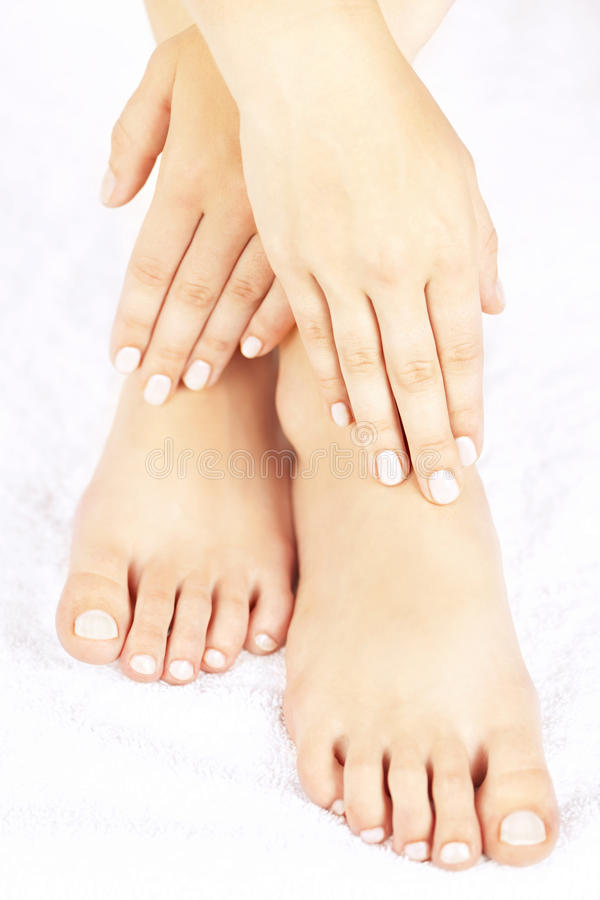Female feet and hands royalty free stock photography