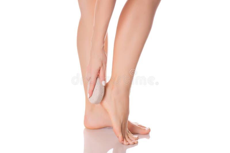 Female feet heel stone pumice. On white background isolation royalty free stock images