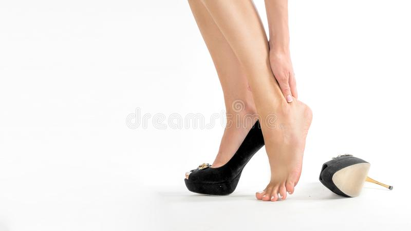 Female feet in pain after wearing high heeled shoes.  royalty free stock photos