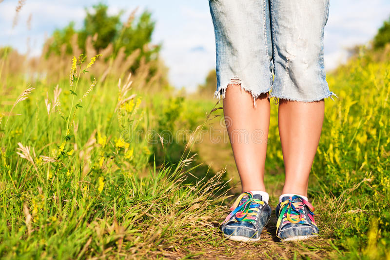 Female feet on the path in the park. royalty free stock photo