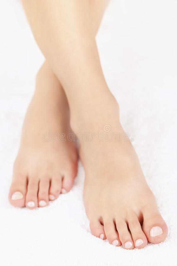 Female feet with pedicure stock photos