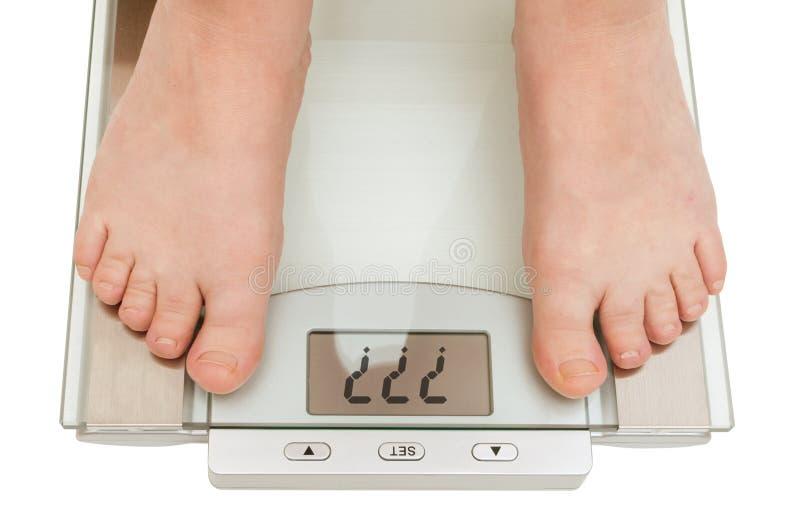 Female feet on scales stock photos