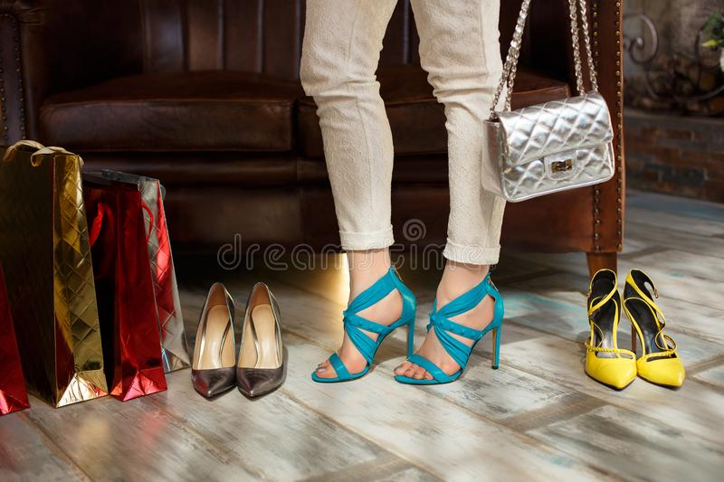 Female feet and shoes. A woman chooses sandals. Model, girl make stock photography
