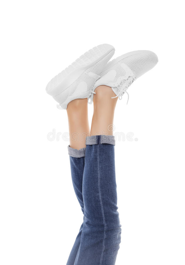 Female feet in sneakers raised up. royalty free stock images