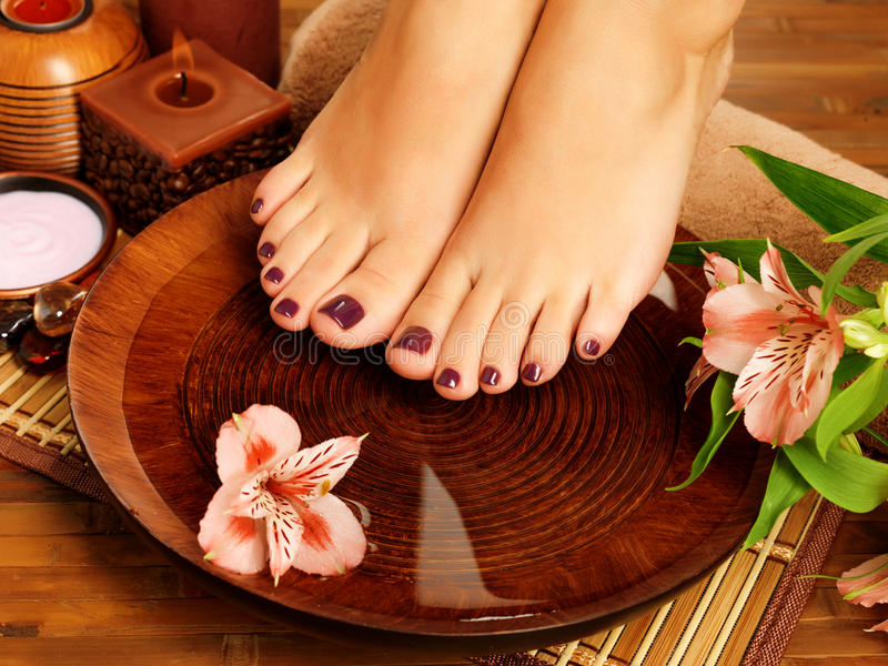 Female Feet At Spa Salon On Pedicure Procedure Stock Photos