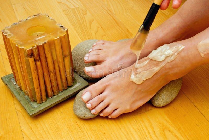 Female feet on spa treatment royalty free stock photos