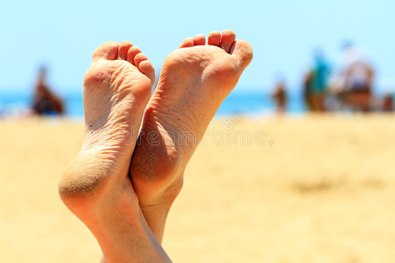 Female feet under the summer sky royalty free stock photo