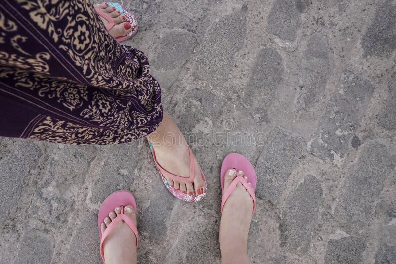 Female feet wearing flip flops royalty free stock image