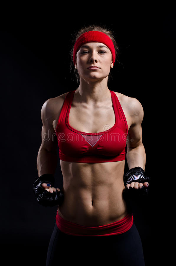 Female fighter in black gloves royalty free stock photos