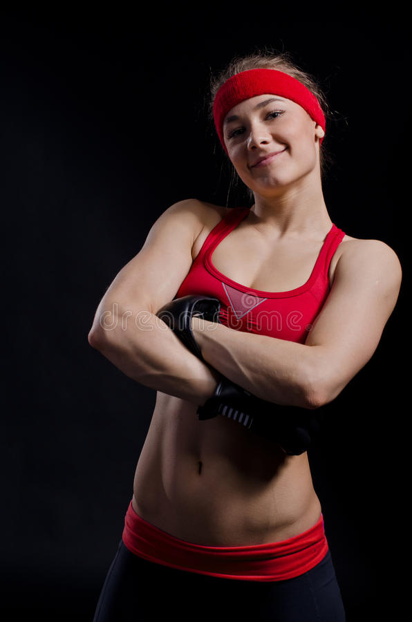Female fighter in black gloves stock photography