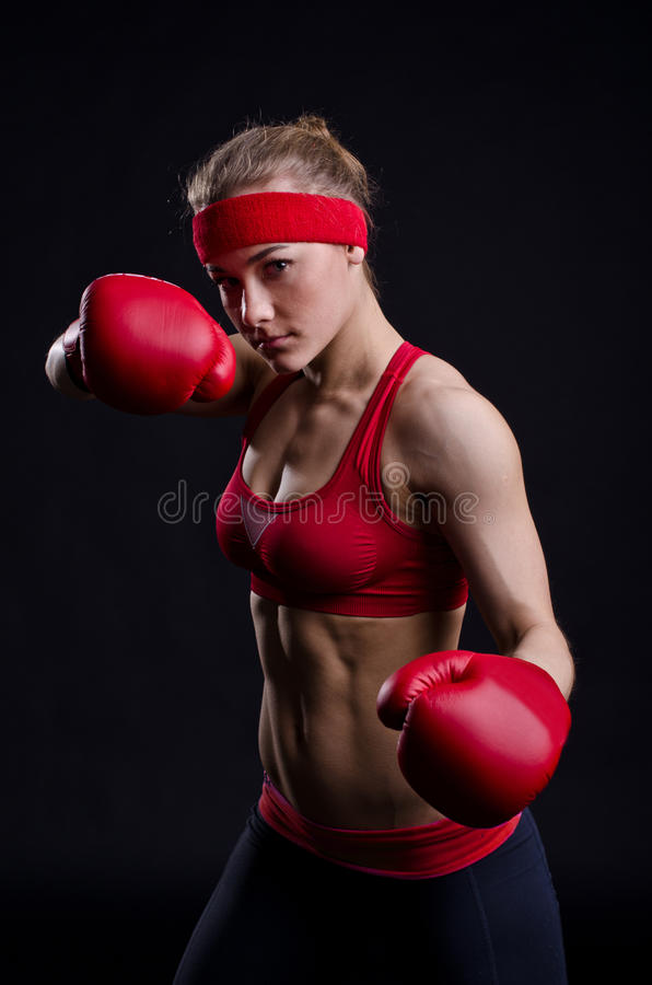 Female fighter in red gloves stock photo