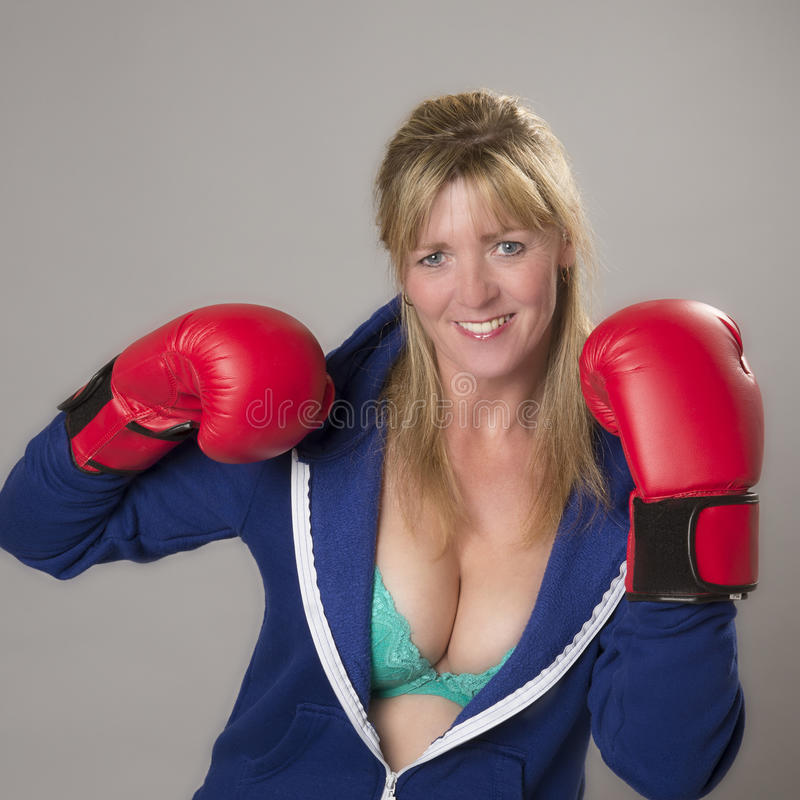 Female fighter wearing red boxing gloves stock photography