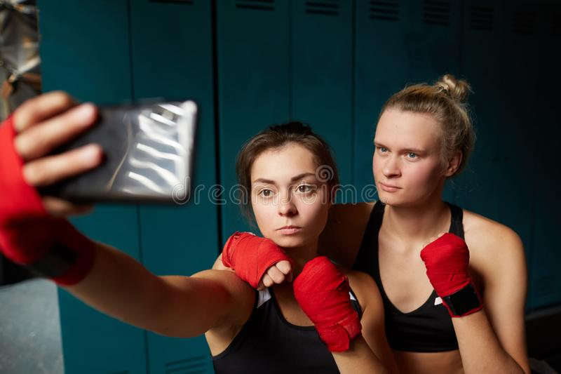Female Fighters Taking Selfie in Club royalty free stock photos