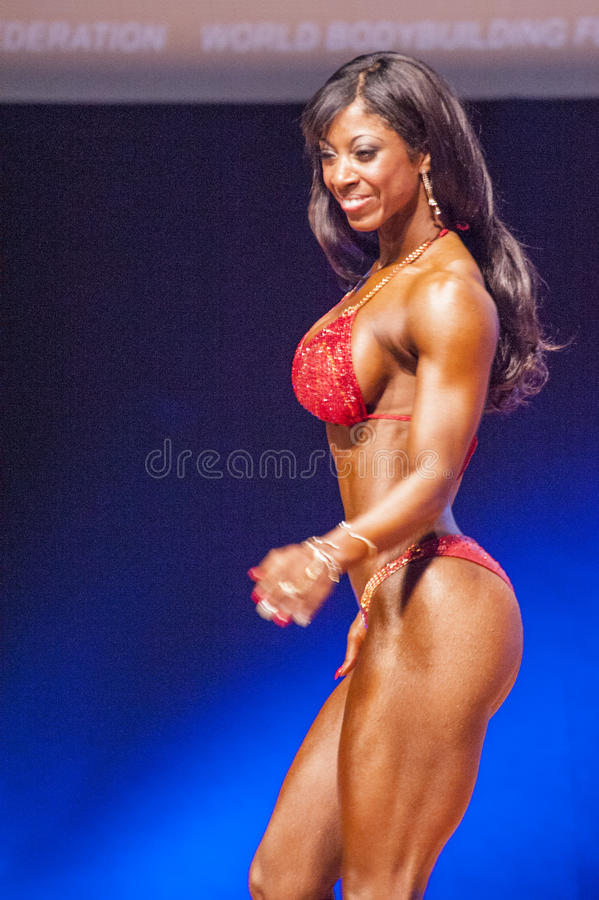 Female figure model shows her best at championship on stage royalty free stock photos