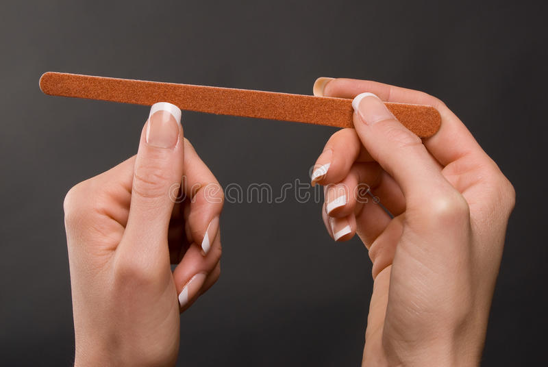 Female filing nails stock photography