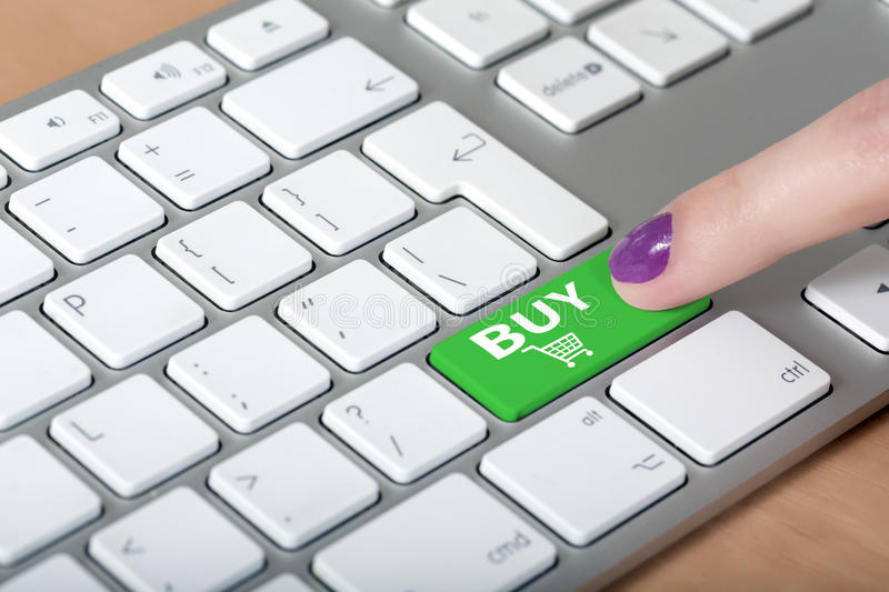 Female finger clicking on BUY button on computer royalty free stock photography