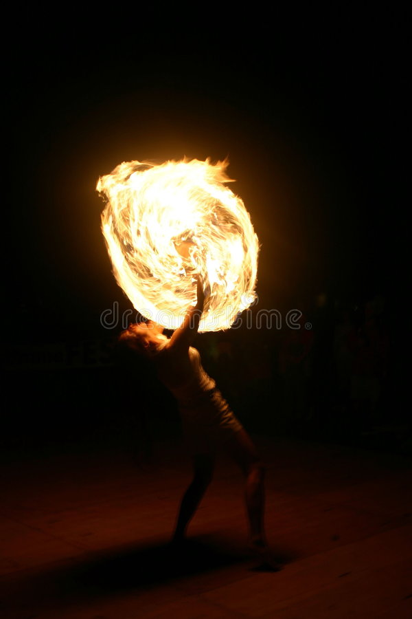 Female Fire juggler. Fire-juggling young woman stock photos