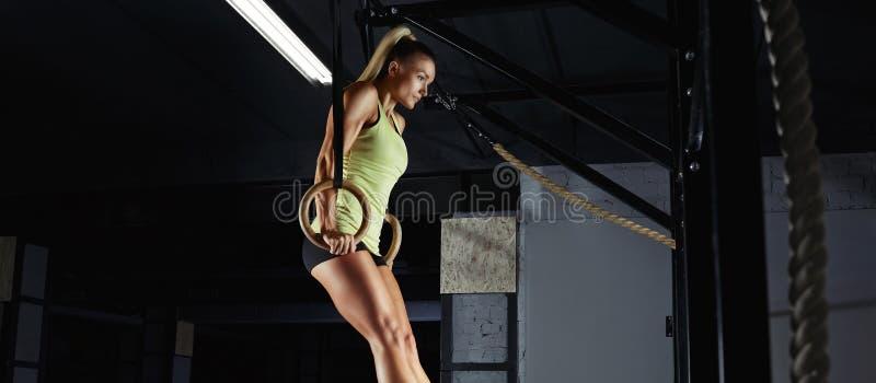 Female fitness athlete exercising stock images