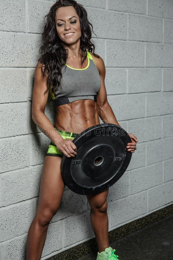 Female fitness model holding barbell weight. stock photo