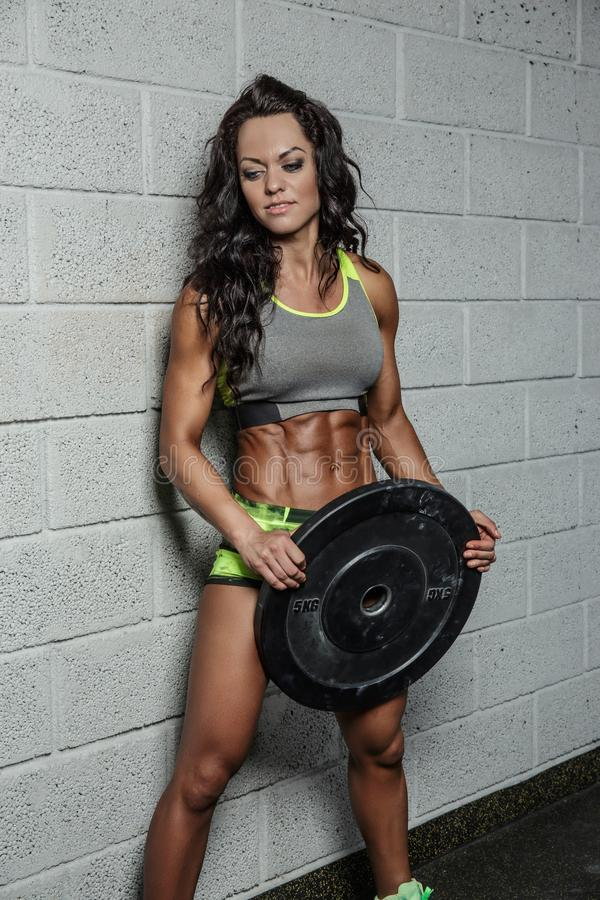 Female fitness model holding barbell weight. royalty free stock photos