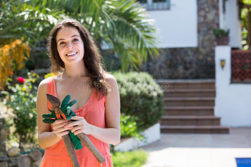 Female florist working in the garden stock photos