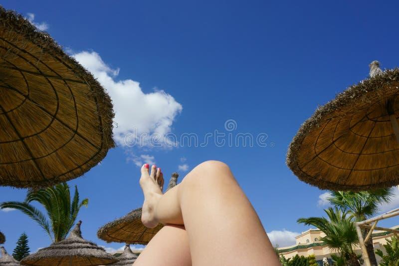 Female foot in flip flops on the beach. Beautiful female foot in flip flops on the beach stock photography