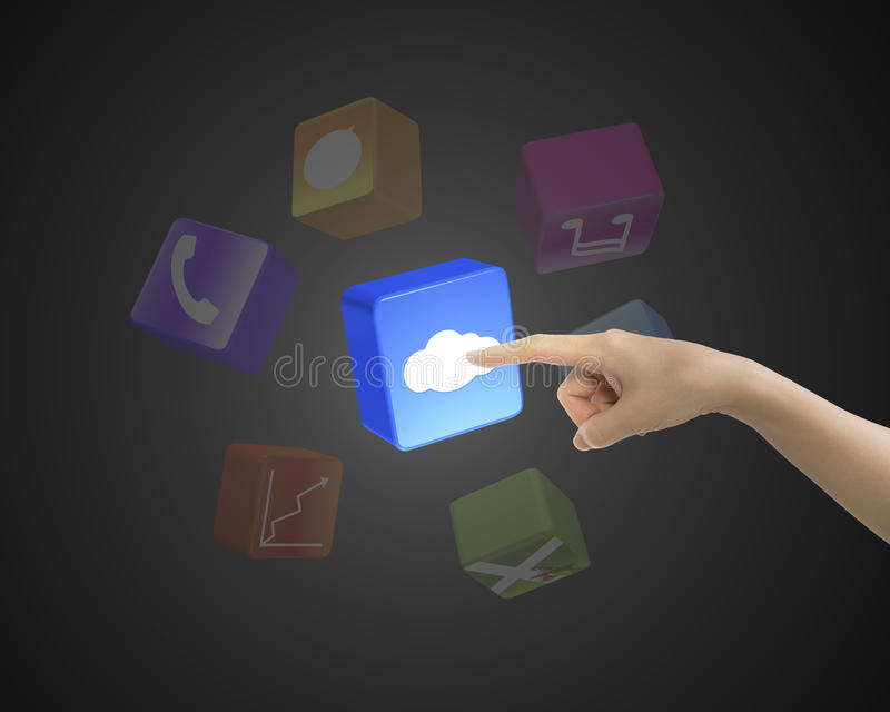 Female forefinger touching cloud icon block with colorful apps. On black background royalty free illustration