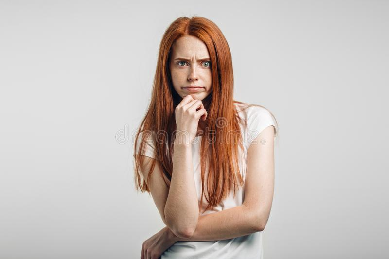 Female with freckles and pursed lips having disappointed unhappy look. Annoyed female with freckles and pursed lips having disappointed unhappy look, frowning stock images