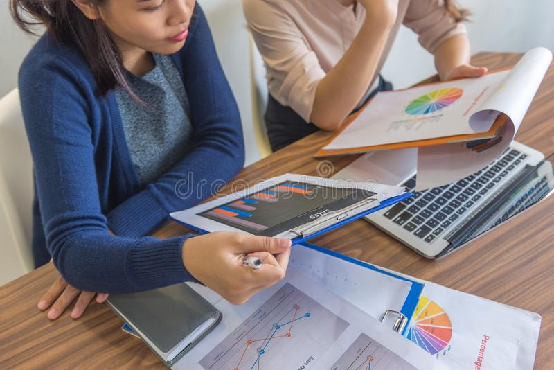 High angle view of businesswomen working on financial statistics documents royalty free stock photos