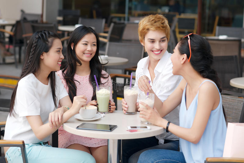 Female friends in the cafe stock images