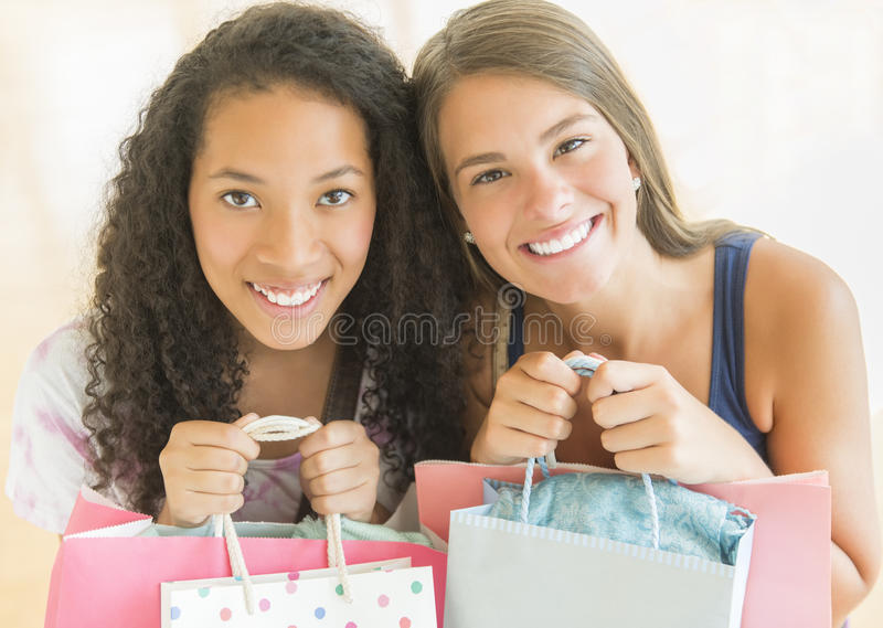 Female Friends Carrying Shopping Bags royalty free stock images