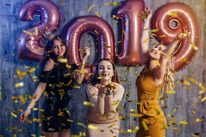 Female friends celebrating playing and dancing. New year, Christmas, Xmas. royalty free stock image