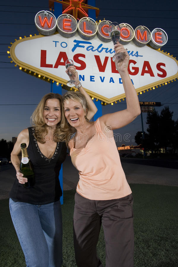 Download Female Friends With Champagne Against 'Welcome To Las Vegas' Sign Stock Image - Image: 29655689