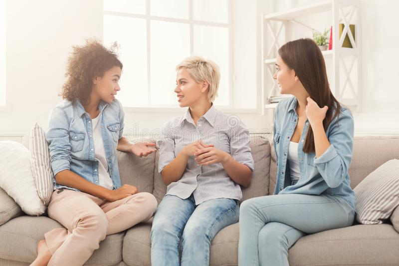 Female friends chatting at home royalty free stock photography