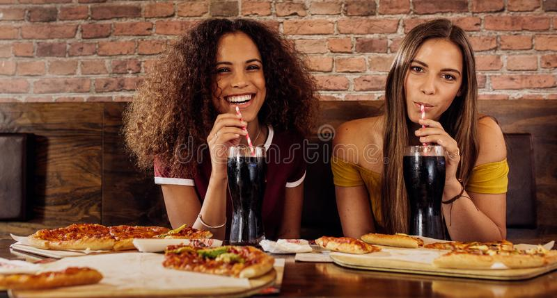 Female friends having lunch at restaurant royalty free stock image