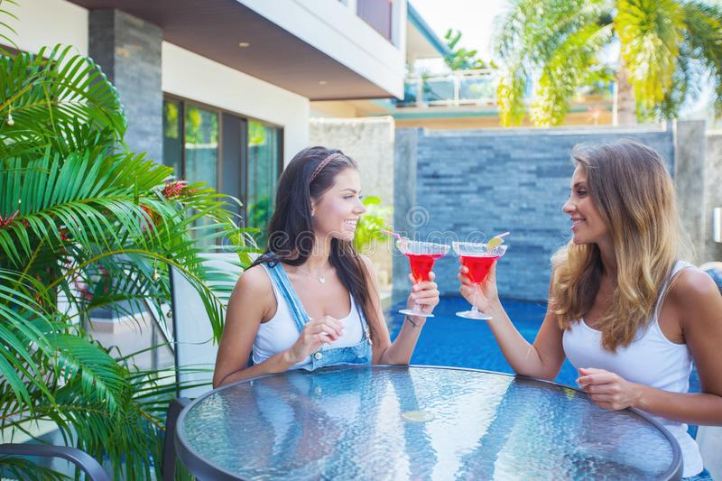 Female friends in outdoor cafe royalty free stock photos