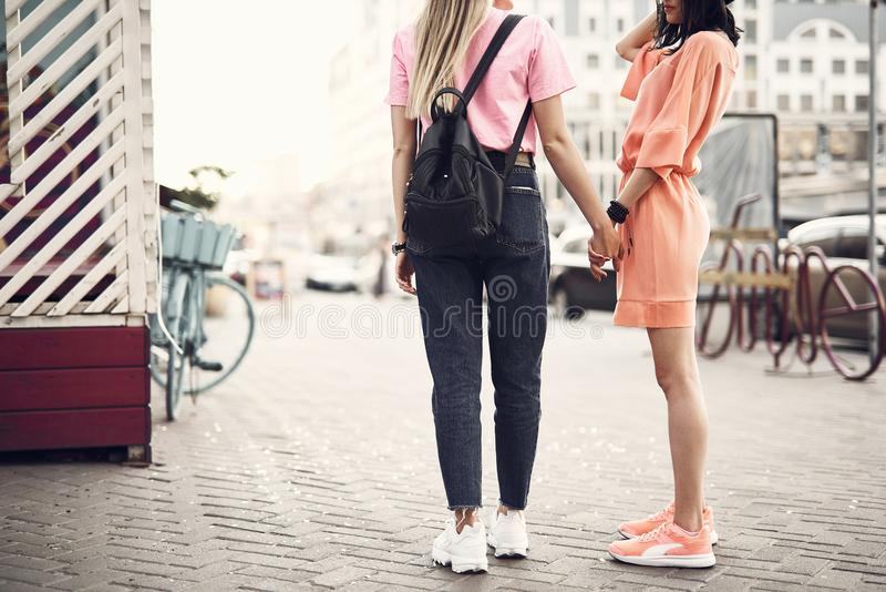 Female friends speaking and going on street royalty free stock photography