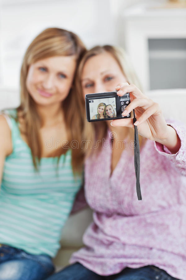 Download Female Friends Taking Pictures Of Themselves Stock Image - Image: 15621787