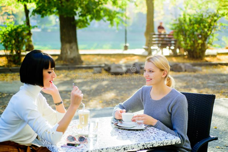Female frienship. Relax with coffee. gossip concept. happy breakfast. coffee time. free time with joy. bisiness meeting. Cafe terrace. happy friends girls stock image